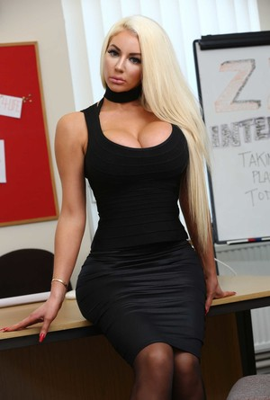 Blonde bombshell Nicolette Shea strips off her black dress at work