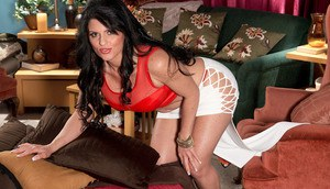 Beautiful mature lady Jade Steele peels off miniskirt as she begins to undress