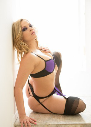 Hot blonde model Alexis Texas parts her butt cheeks in black nylons and heels