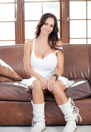 Brunette MILF Ava Addams unleashes her nice melons as she undresses
