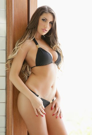 Sexy model August Ames slowly removes her bikini to stand nude in the doorway