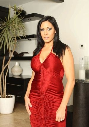 Hot Latina MILF Raylene peels off red dress and lingerie to pose nude