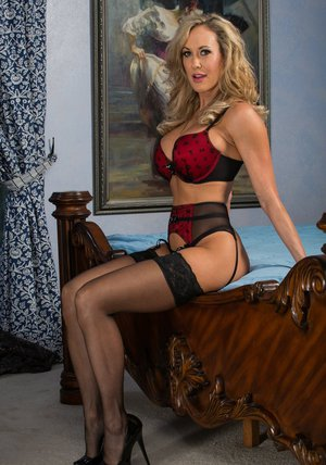 Busty minx in stockings Brandi Love stripping off her lingerie