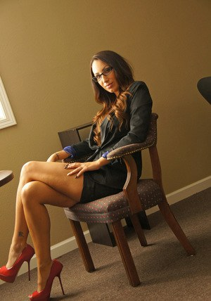 Leggy secretary exposes her nice tits to go with a no panty upskirt
