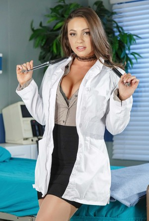 Hot female doctor Abigail Mac doffs her lab coat and clothes to pose nude
