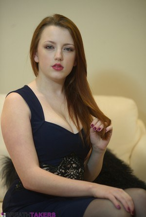 Fair skinned redhead Lauren Louise slides her hand down sexy panties on a sofa