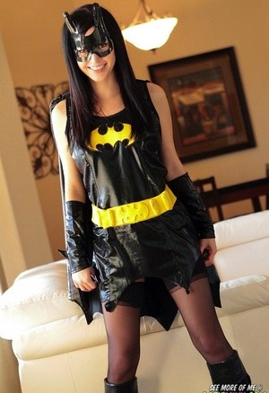 Dark haired chick Catie Minx takes off a Batman suit to model in the nude