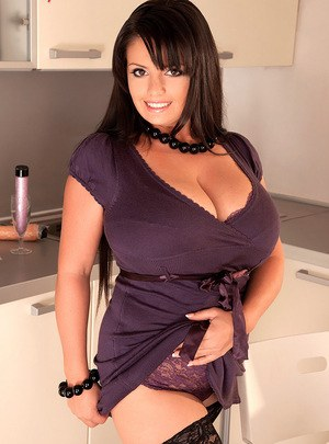 Thick big breasted MILF Arianna Sinn using a sex toy in the kitchen