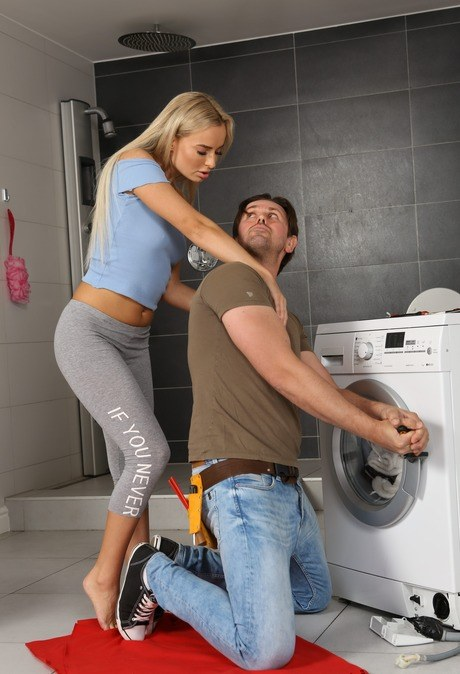 Horny blonde Victoria Pure plays pee games with the appliance repairman