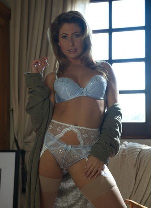 Solo model Sarah frees her firm tits from a bra in garters and nylons