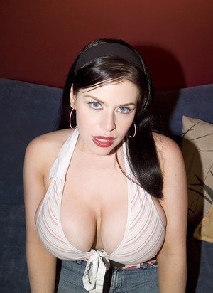 Brunette MILF with red lips Daphne Rosen uncorks knockers for a man's benefit