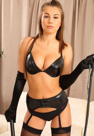Leather clad Sarah James poses topless in black stockings with her whip