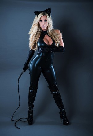 Hot blonde Xo Gisele slowly peels off her leather catsuit in sexy manner