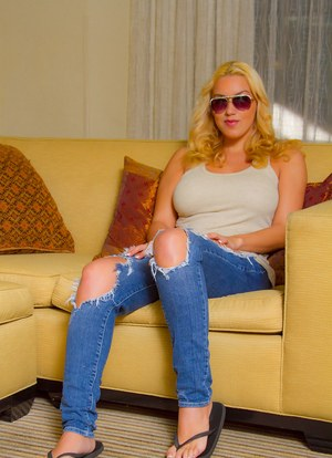 Blonde amateur in jeans and glasses strips to show the world her big tits