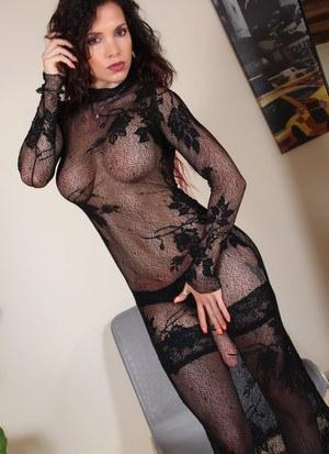 Hot brunette Lady Scarlet struts about in heels wearing a strapon cock