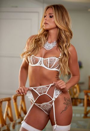 Solo model Ella Silver strikes great poses in white stockings and garters