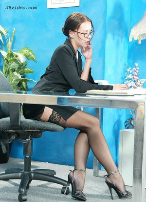 Hot secretary strips to backseam nylons and garters on her office desk