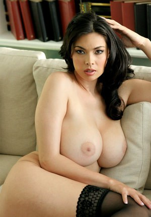 Exotic Asian pornstar Tera Patrick flaunting nice melons in black nylons