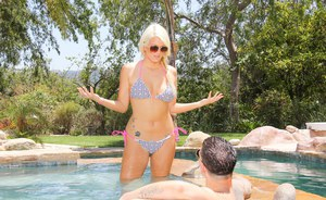 Hot blonde in bikini gobbles hard cock by the pool and fucks like a bunny
