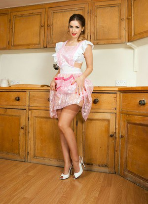 Housewife Stella Cox removes her dress to model in retro lingerie and hose