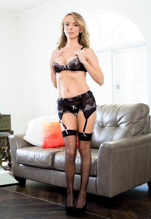 Sexy blonde looker in black lace lingerie enjoys big black cock doggystyle