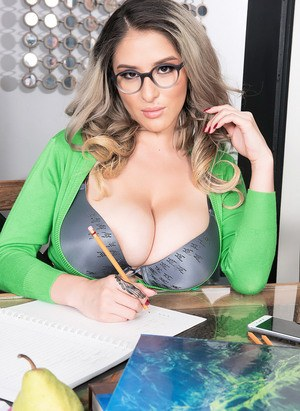 Glasses clad Katy Shavon looses her massive big tits and lets them hang free