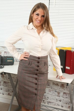 Hot secretary Siobhan Graves in nylon stockings takes off her skirt at office