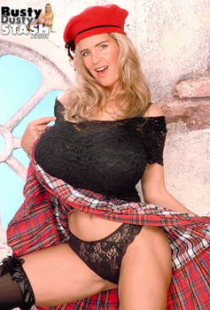 Blonde pornstar Dusty displays her massive knockers while touching her twat