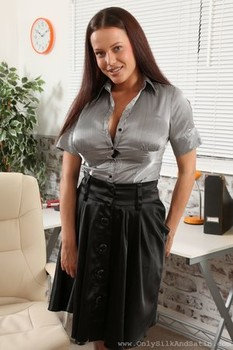 Busty secretary Elle Faye strips in the office and shows lingerie and breasts