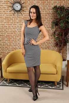 Dark haired secretary Brooke Ashleigh poses in panties and stockings on sofa