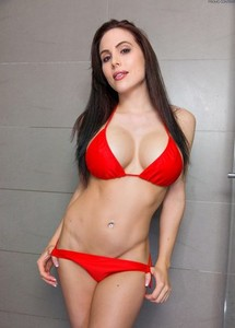 Hot brunette Katie Banks removing wet bikini in the shower to show huge tits