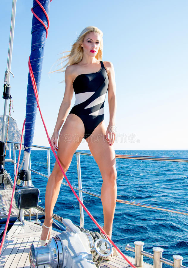 Stunning leggy blonde in a swimsuit