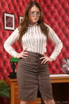 Brown haired babe wearing pantyhose Brooke G gets topless in an office room