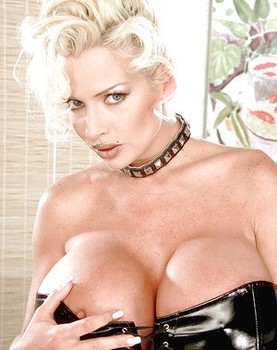 Blonde babe SaRenna Lee unleashes huge pornstar tits from latex bra