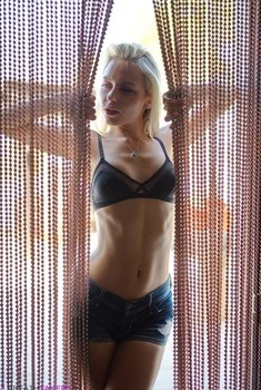 Blonde girl Chloe Toy drinks and smokes while modeling lingerie