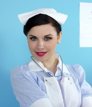 Sexy vintage nurse Jocelyn-Kay removes her uniform to cheer up the patients