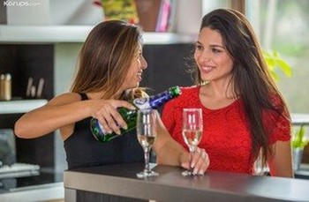 Lesbian women Frida Sante and Zafira lick pussies after a bottle of wine