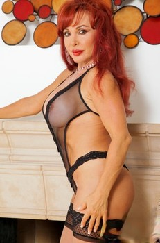 Redhead Vanessa Bella unveils juicy big boobs & toys shaved pussy in stockings