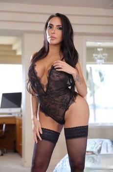 Beautiful Latina Lela Star displays her big juggs and bubble ass in stockings