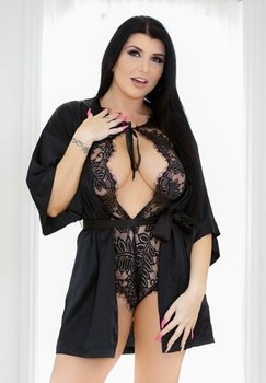 Dark haired woman Romi Rain unleashes her huge boobs as she removes lingerie