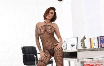 Solo model Gemma Massey rocks her big tits as she removes mesh bodystocking