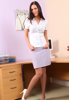 Tall secretary Andrea uncups her firm tits at work in panties and nylons
