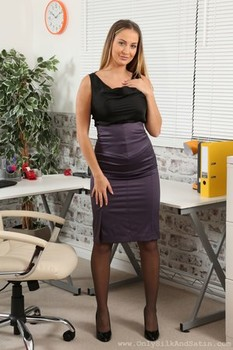 Stunning hottie Suzie Q removes her office outfit and reveals huge bosom