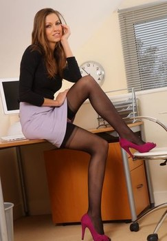 Long legged secretary Eufrat shows her nice tits and ass in nylons at her desk