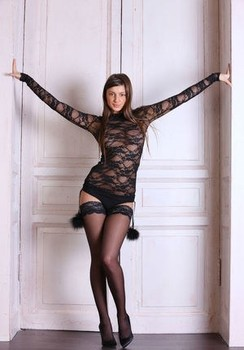 Russian solo girl Melena A sheds her sheer dress to model in stockings only