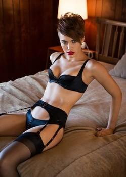 Brunette American babe in black lingerie Britt Linn shows her tiny tits