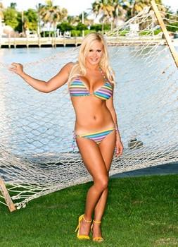 American bombshell Nichole Van Croft sunbathing her massive silicone tits
