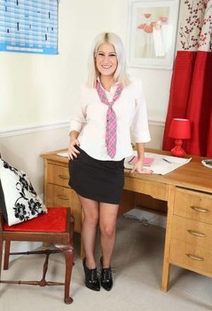 Blonde secretary Lu shows her bare ass and twat in backseam nylons and heels