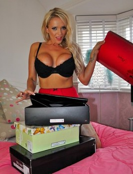 Hot blonde Lucy Zara changes into sexy attire before a live webcam show
