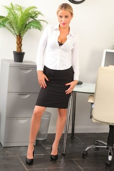 Slender blonde secretary Rosie W changes outfits in the office and shows boobs